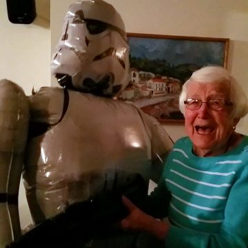 Life-sized Star Wars Storm Trooper balloon with mom