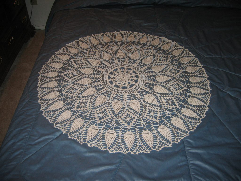30-inch diameter crocheted doily displayed on bed
