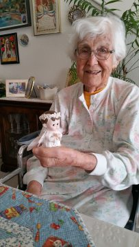 Frances holding cherub figurine